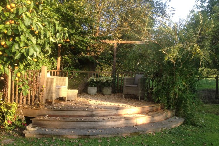 Peaceful outside sitting area welcomes One to One's - Yoga and Meditation.