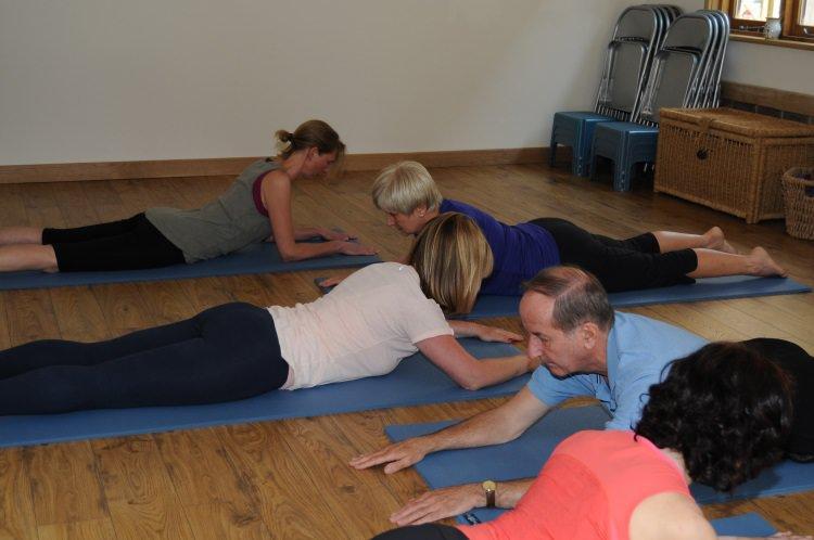 Students practising in Yoga Studio in Guildford